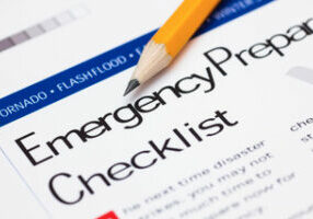 Emergency Preparedness Checklist with pencil. Close-up.