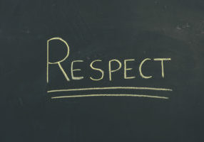 "Chalkboard sign with handwritten letters ""Respect."""