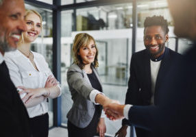 Cropped shot of businesspeople shaking hands in an office