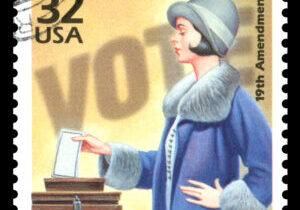 USA vintage postage stamp showing an image of a woman voting in the 1920's commemorating women's suffrage